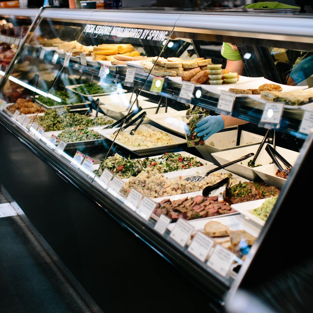 The New Seasons Market deli offers freshly prepared food sold by the pound including customer favorites like Asian Chicken Meatballs, Orzo Pasta Salad, and more