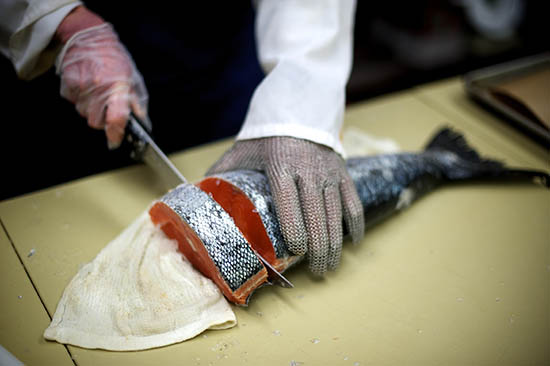 a whole fish being butchered