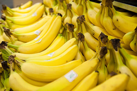 rows of bright yellow bunches of bananas