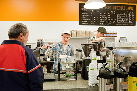 two employees making coffee
