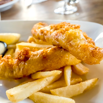 plate of fish and chips with fries