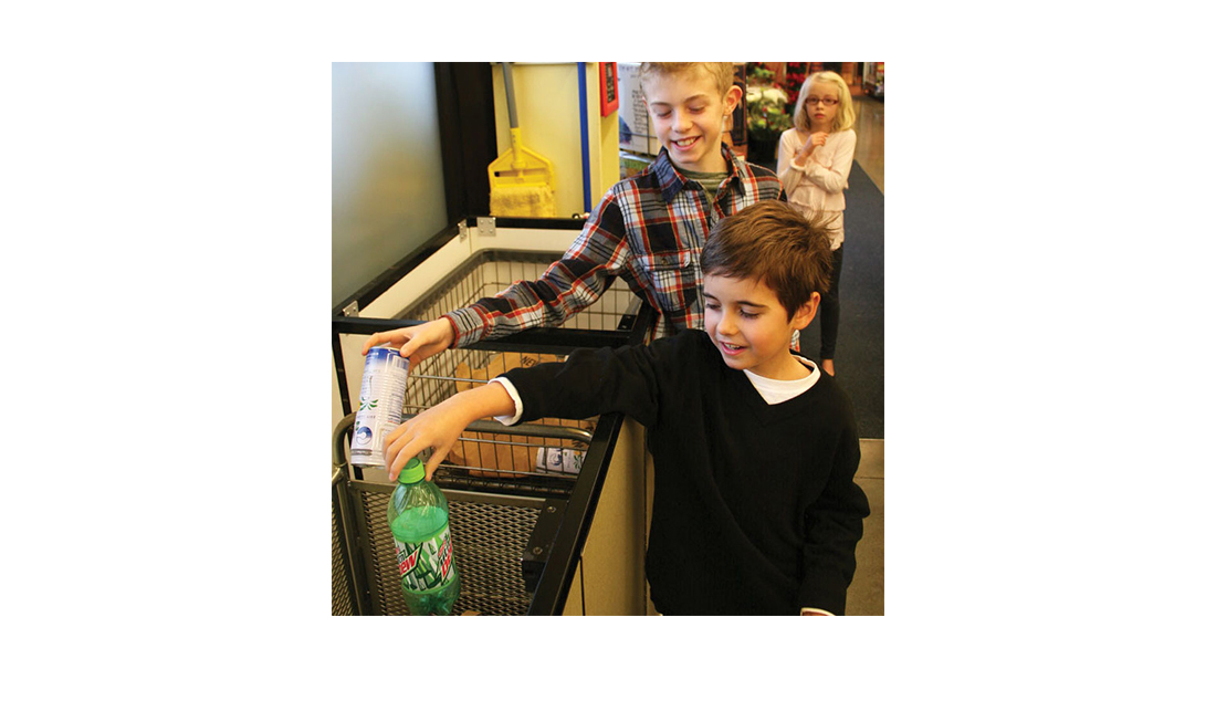 children recycling empty bottles and cans