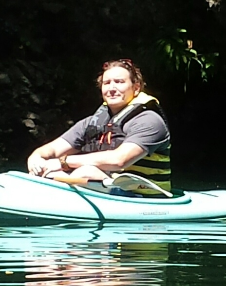 person in a green kayak